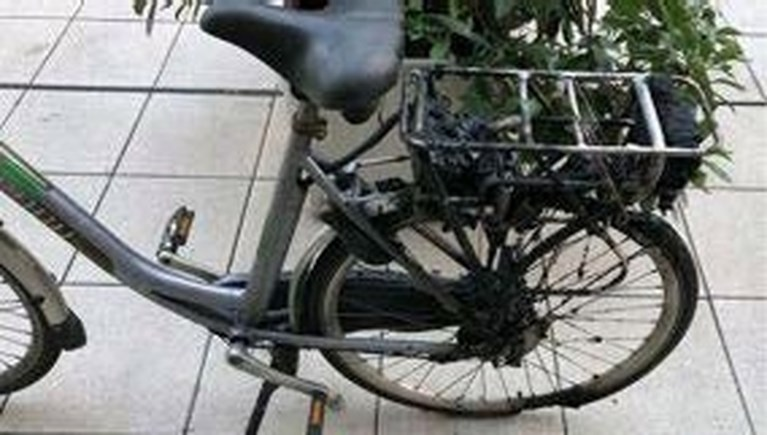 Opgebrande fietsbatterij door oververhitting.